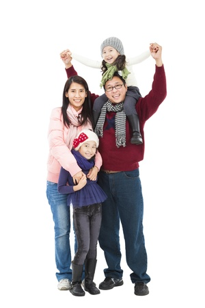 happy asian family: full length of happy asian family in winter clothes standing together and isolated on white Stock Photo
