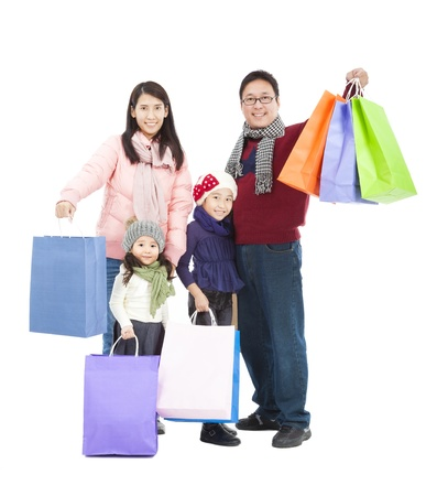 happy shopping: happy asian family with shopping bag in winter clothing Stock Photo