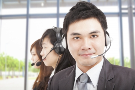 phone operator: smart asian businessman with call center agent Stock Photo