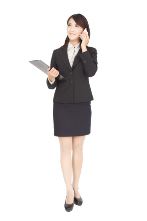 smiling asian  businesswoman with phone isolated on white photo