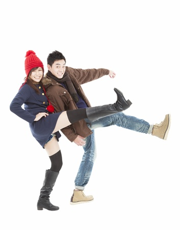 Young happy  couple in winter clothing and isolated on white photo