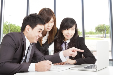 colleague: happy asian business team working in office