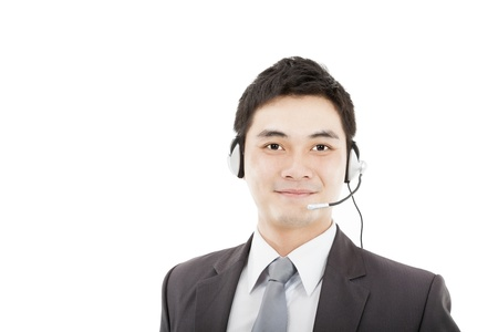 handsome businessman wearing headset and smiling isolated on white  photo