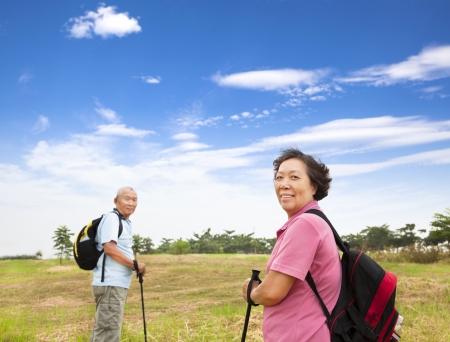 senior health: happy asian senior couple hiking in the nature Stock Photo