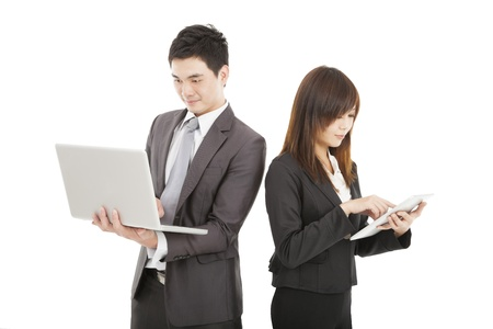 businessman and businesswoman using laptop and tablet pc photo