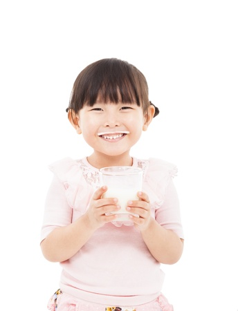 human milk: asian  little girl holding a glass of fresh milk  Stock Photo