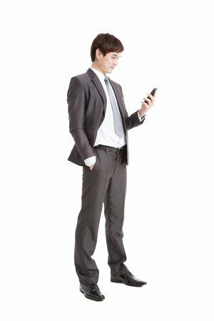 full length of Successful businessman holding smart phone isolated on white photo