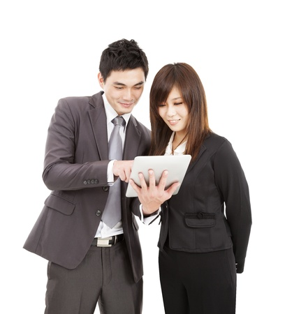 businessman and businesswoman using the tablet pc photo