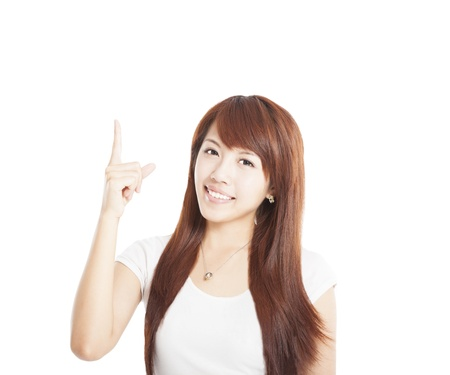 asian teacher: young asian Woman smiling and pointing up Stock Photo