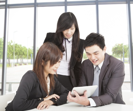 business team working in the office and watching the tablet pc Stock Photo - 16216438