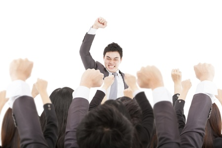 team victory: excited businessman with success business team