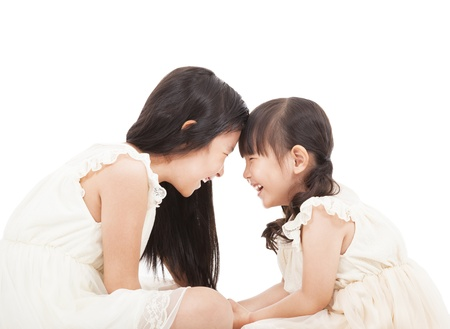 happy two little girls looking each other Stock Photo