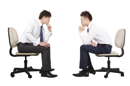 sitting chair: two businessman thinking and looking each other