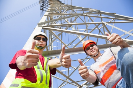 two power line workers with thumbs up photo