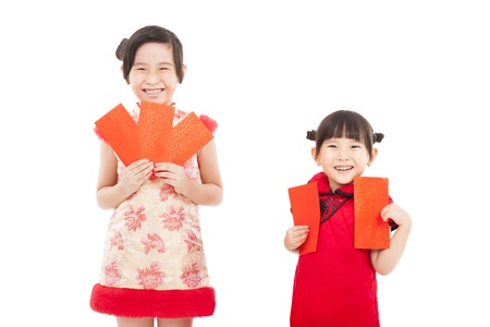 happy chinese new year. smiling asian little girls holding red envelope photo