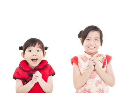 chinese dress: happy chinese new year. two asian girls with Congratulation gesture