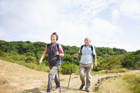happy asian senior couple hiking  Stock Photo