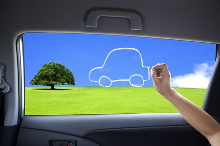 hand drawing eco green car concept on the car windows Stock Photo - 16559189