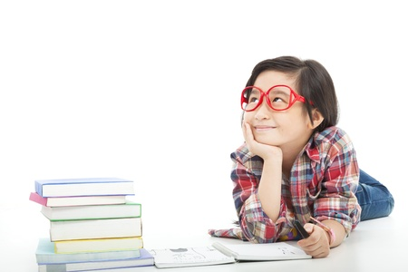 women children: asian little girl  thinking  during preparing homework