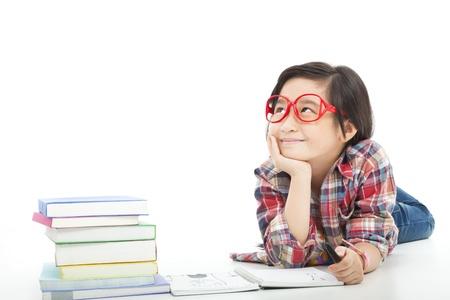 study concept: asian little girl  thinking  during preparing homework