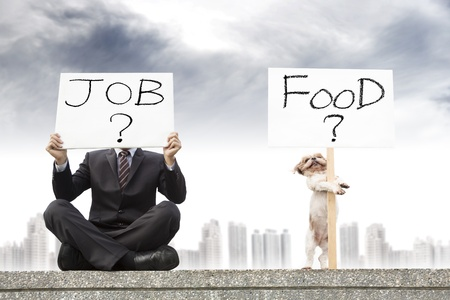 looking for work: businessman looking for a job and dog looking for the food Stock Photo