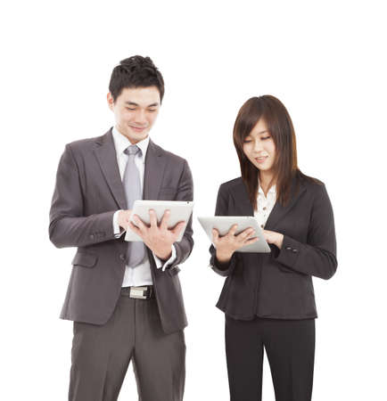 touch pad: businessman and businesswoman using tablet pc