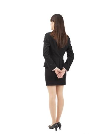 espalda: Vista posterior de la joven empresaria Foto de archivo