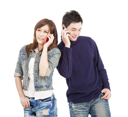 happy asian couple talking on the phone  photo