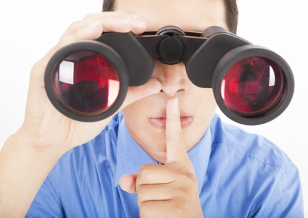 man looks through binoculars with silent gesture Stock Photo - 17240386