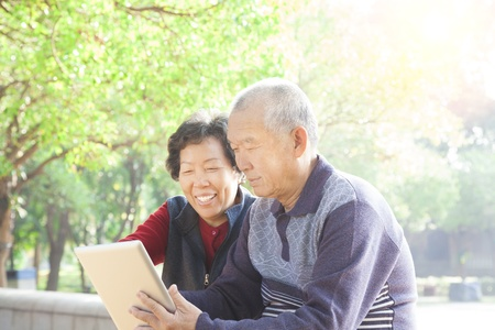 happy asian  Senior couple with tablet pc photo