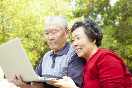 happy  Senior couple learning with laptop Stock Photo