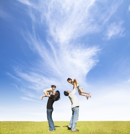 happy family on the grass with cloud background photo