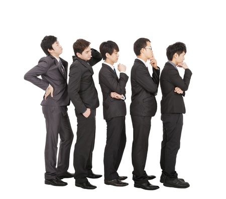 to queue: Group of businessman standing in a line waiting