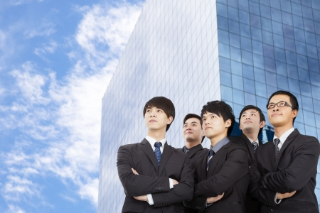 young business team standing before the modern building photo