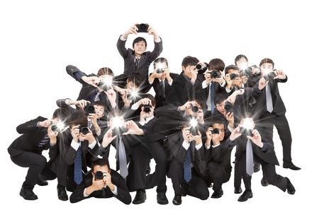 journalists: many photographers holding camera pointing to you and isolated on white
