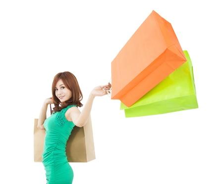 asian shopper: young woman holding shopping bag Stock Photo