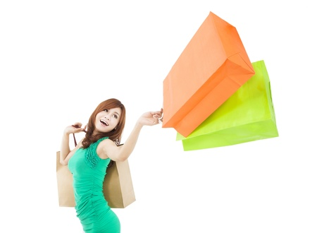 bags in hands: happy young woman holding shopping bag