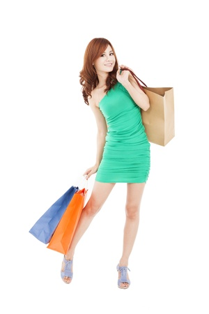 full length of happy asian woman with shopping bag Stock Photo - 17663449