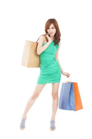 full length of happy young woman with shopping bag Stock Photo - 17663450