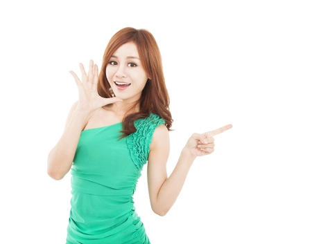 happy young woman shouting and pointing at something Stock Photo - 17663452