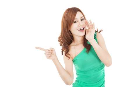 smiling asian young woman shouting and pointing  photo