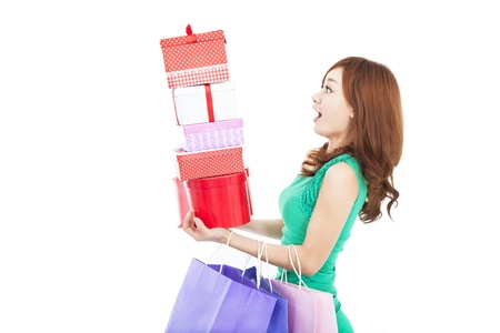surprised young woman holding gift box and shopping bag photo