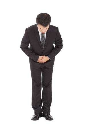 kindly: full length of asian businessman with bow and kindly gesture Stock Photo
