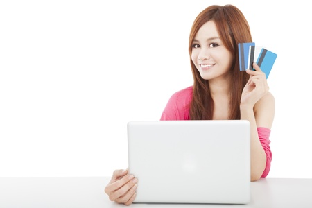 beautiful young woman holding credit card with laptop photo