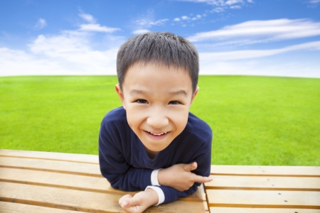 asian family outdoor: close up of smiling asian boy