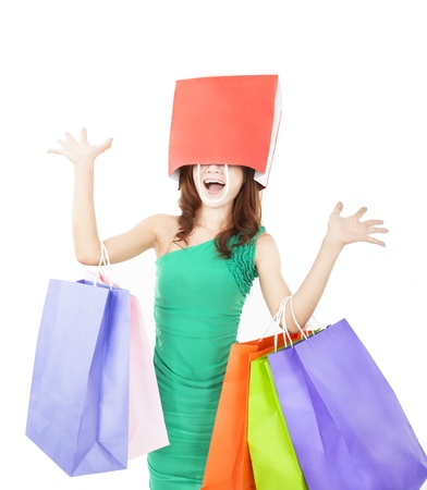 excited young woman with shopping bag on the head photo