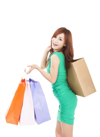 asian shopper: happy young asian woman holding shopping bag Stock Photo