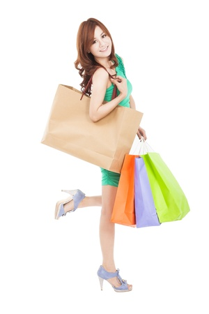 asian shopper: full length of happy asian woman with shopping bag