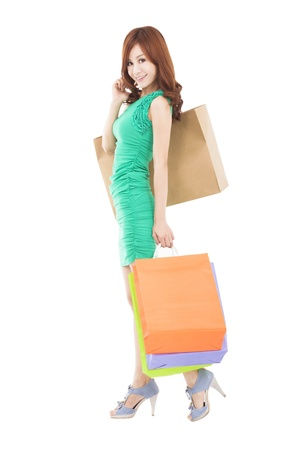full length of smiling asian woman with shopping bag photo