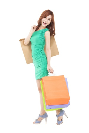 full length of young asian woman with shopping bag photo